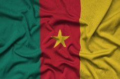 Cameroon flag is depicted on a sports cloth fabric with many folds. Sport team banner royalty free stock image