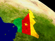 Cameroon with flag on Earth Stock Image