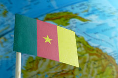 Cameroon flag with a globe map as a background Royalty Free Stock Images