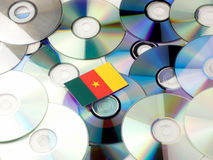 Cameroon flag on top of CD and DVD pile isolated on white Royalty Free Stock Photo