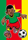 Cameroon soccer player with flag background Royalty Free Stock Photos