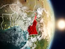 Cameroon during sunrise. Highlighted in red on planet Earth with visible country borders. 3D illustration. Elements of this image furnished by NASA Royalty Free Stock Photo