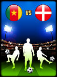 Cameroon versus Denmark on Stadium Event Background Stock Image