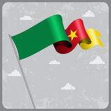 Cameroon wavy flag. Vector illustration. Stock Image
