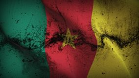 Cameroon grunge dirty flag waving on wind. Cameroonian background fullscreen grease flag blowing on wind. Realistic filth fabric texture on windy day Stock Photography