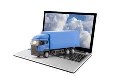 Camión azul en el ordenador portátil en el fondo blanco fotos de archivo libres de regalías