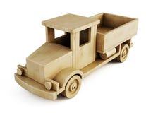 Camión de madera del juguete aislado en el fondo blanco 3d Fotografía de archivo