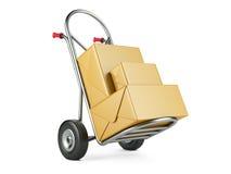 Camión de mano con los paquetes del cartón Concepto de la salida Imágenes de archivo libres de regalías