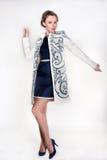 Camice d'uso della donna specializzata con gli ornamenti Fotografia Stock