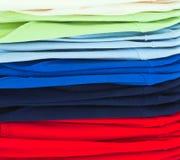 Camice di sport multicolori in memoria Immagine Stock