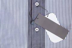 Camicia con l'etichetta Fotografia Stock