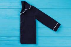 Camicia dei pigiami piegata a metà Fotografia Stock