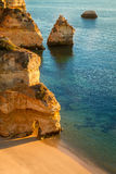 Camilo Beach, Lagos, Algarve, Portugal. Camilo beach or Praia do Camilo as its locally known. A beautiful golden sandy beach with interesting rock formations on stock photo