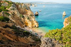 Camilo Beach in Lagos, Algarve, Portugal. A tiny secret beach between the limestone walls. 200 wooden steps down to sheltered, san. Camilo Beach in Lagos Royalty Free Stock Images