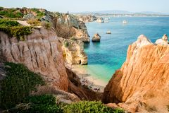 Camilo Beach in Lagos, Algarve, Portugal. A tiny secret beach between the limestone walls. 200 wooden steps down to sheltered, san. Camilo Beach in Lagos Stock Photo