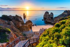 Camilo Beach (Praia do Camilo) at Algarve, Portugal with turquoise sea in background. Wooden footbridge to beach Praia do Camilo,. Portugal. Wonderful view of stock image