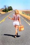 Caminante de tirón atractivo que lo manosea con los dedos Imágenes de archivo libres de regalías