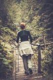 Caminante en un bosque Fotografía de archivo libre de regalías