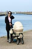 Caminata con el cochecito de niño Imágenes de archivo libres de regalías