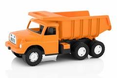 Caminhão basculante do vintage isolado no fundo branco com reflexão da sombra Brinquedo plástico da criança no contexto branco foto de stock royalty free