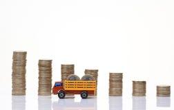 Caminhão com moedas Fotografia de Stock