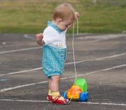 Caminhão da criança e do brinquedo Fotografia de Stock Royalty Free
