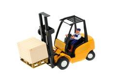 Caminhão de empilhadeira e brinquedo do motorista Fotos de Stock Royalty Free
