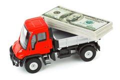 Caminhão do brinquedo com dinheiro Fotos de Stock Royalty Free