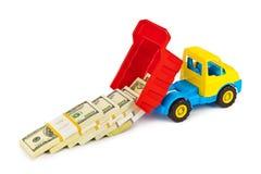 Caminhão do brinquedo com dinheiro Fotografia de Stock