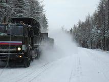 Caminhão na estrada do inverno Fotografia de Stock Royalty Free