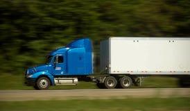 Caminhão rápido do frete na estrada Imagem de Stock Royalty Free