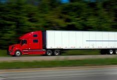 Caminhão rápido do frete na estrada Fotografia de Stock Royalty Free