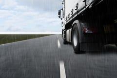 Caminhão rápido na rua Fotografia de Stock Royalty Free