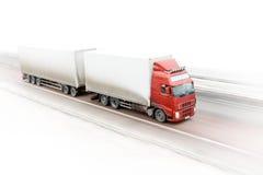 Caminhão vermelho na estrada Imagens de Stock