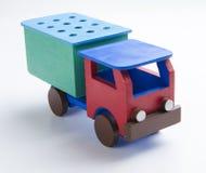 Caminhãozinho. Pequeno caminhão de brinquedo de madeira vermelho e verde. Small red and green wooden toy truck Stock Photos