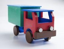 Caminhãozinho. Pequeno caminhão de brinquedo de madeira vermelho e verde. Small red and green wooden toy truck Royalty Free Stock Photography