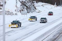 Caminhões do arado na estrada após a tempestade 2013 Imagem de Stock