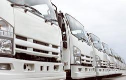 Caminhões em uma fileira Fotografia de Stock