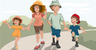 Caminhada da família no parque Fotografia de Stock Royalty Free
