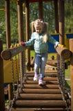 Caminhada da menina na corrediça exterior Foto de Stock Royalty Free