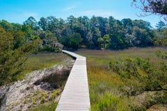 Caminhada da placa da região pantanosa Fotografia de Stock Royalty Free