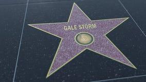 Caminhada de Hollywood da estrela da fama com inscrição da TEMPESTADE do VENDAVAL Grampo editorial video estoque