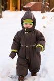 Caminhada do bebê no dia de inverno Imagem de Stock Royalty Free