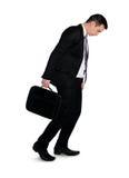 Caminhada do homem de negócio comprimida Foto de Stock