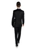 Caminhada do homem de negócio para trás Imagem de Stock Royalty Free