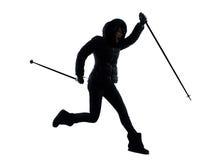 Caminhante da mulher que caminha a silhueta feliz de salto Foto de Stock