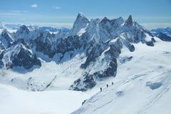 Caminhantes em alpes franceses Fotografia de Stock