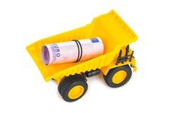 Caminhão do brinquedo com dinheiro Foto de Stock