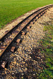 Caminhos de ferro através do prado Foto de Stock Royalty Free