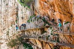 Caminito del Rey, Spain, April 04, 2018: Royal Trail also known as El Caminito Del Rey - mountain path along steep cliffs in gorge. Chorro, Andalusia, Spain stock image